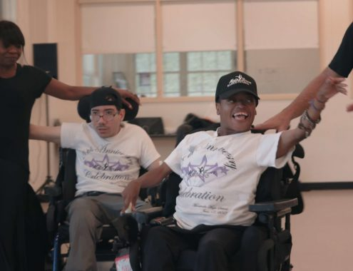 disabled people smiling while dancing